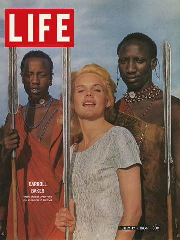 ACTRESS CARROLL BAKER WITH MASAI WARRIORS